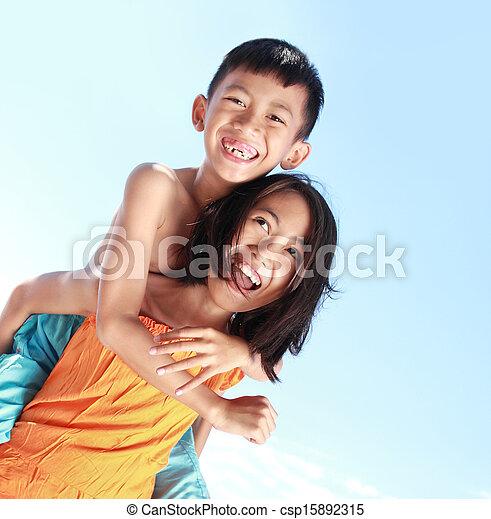 Happy kids having fun doing piggyback ride