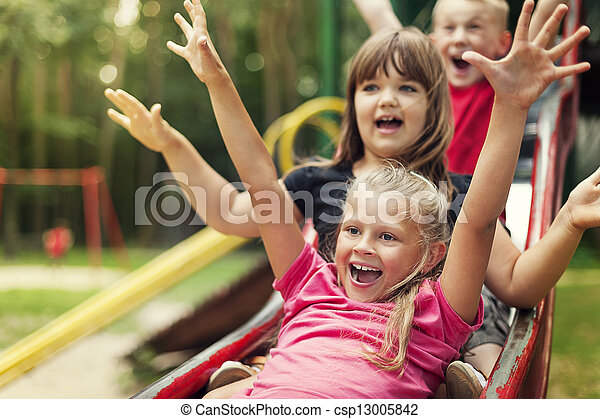 Happy kids playing on slide - csp13005842