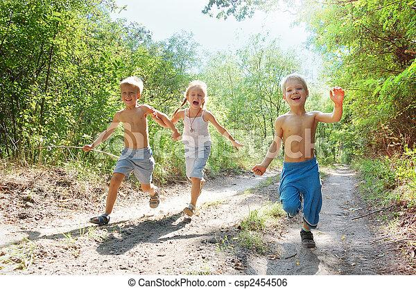 happy kids running in the woods - csp2454506