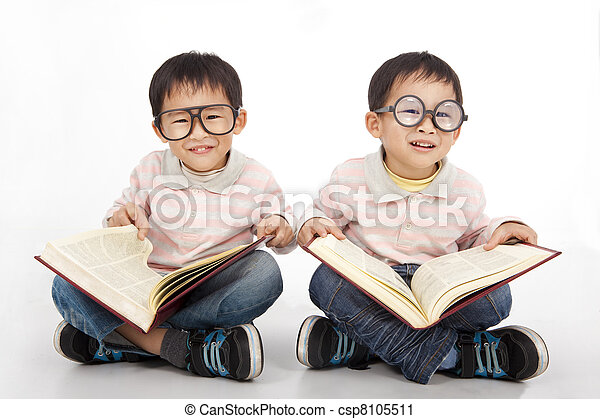 Happy kids with big book wearing black glasses - csp8105511