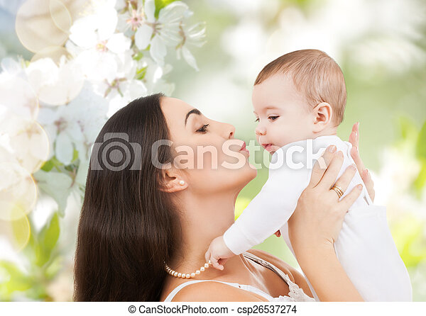 happy laughing baby playing with mother - csp26537274