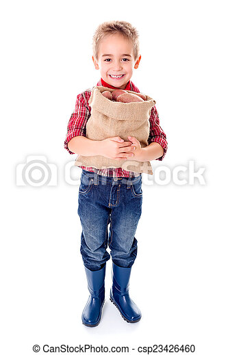 Happy little agriculturist holding potato harvest - csp23426460