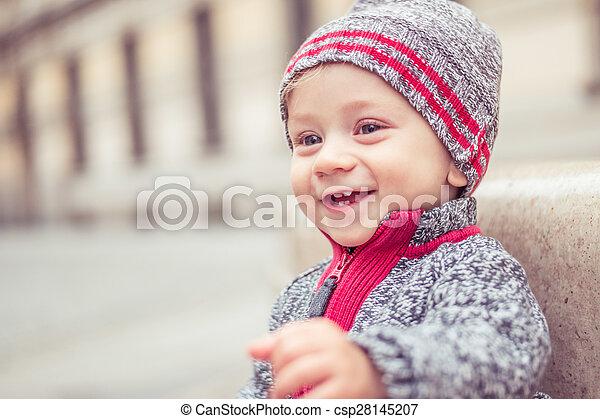 Happy Little Baby Boy Wearing Hat In The City