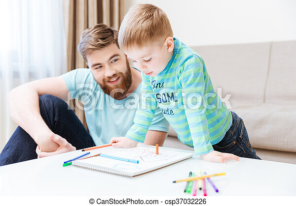 Happy little boy and his father drawing together - csp37032226