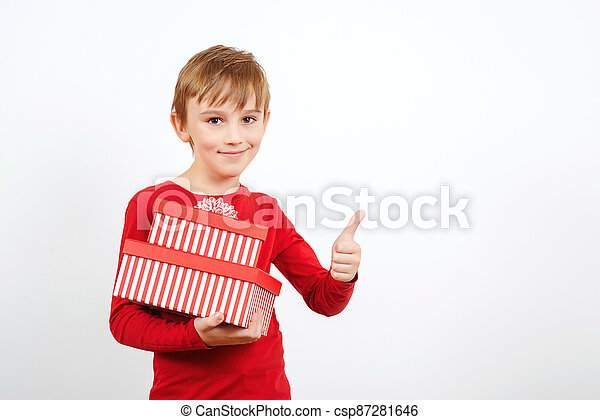 Happy little boy with presents isolated over white background. Cute boy with present box. - csp87281646