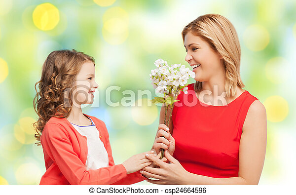 happy little daughter giving flowers to her mother - csp24664596