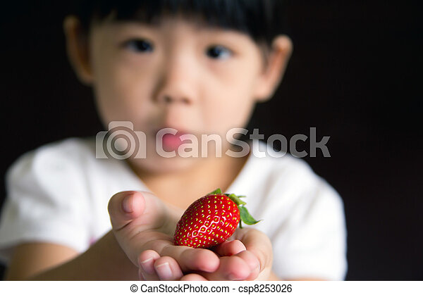 Happy little girl hold a strawberry - csp8253026