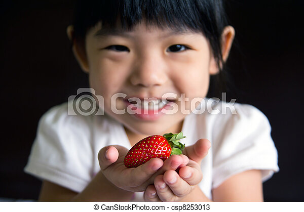 Happy little girl hold a strawberry - csp8253013