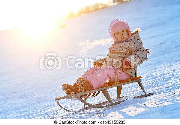 happy little girl in winter on sled - csp43155235