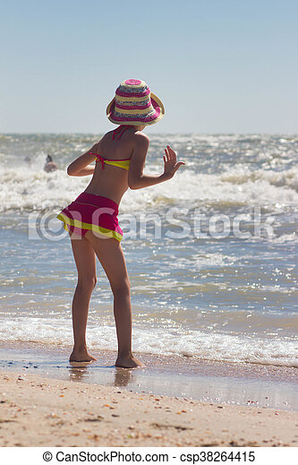 Happy little girl playing at beach - csp38264415
