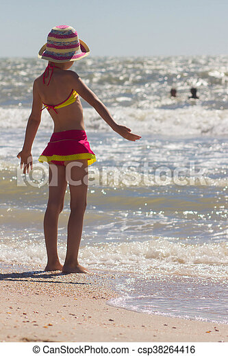 Happy little girl playing at beach - csp38264416