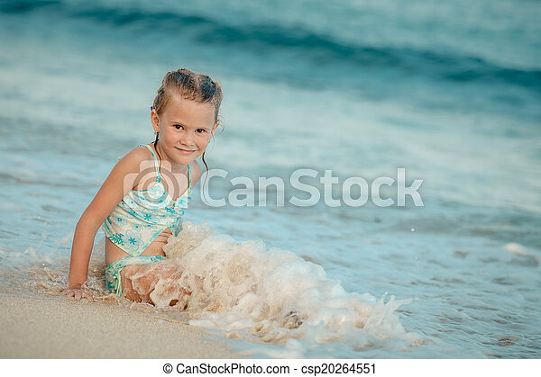 happy little girl splashing in the sea - csp20264551