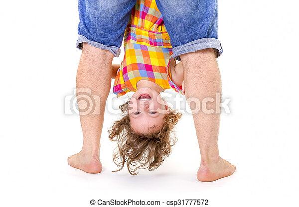 Happy little girl upside down - csp31777572