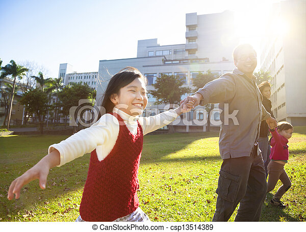 happy little girl with family in the park - csp13514389