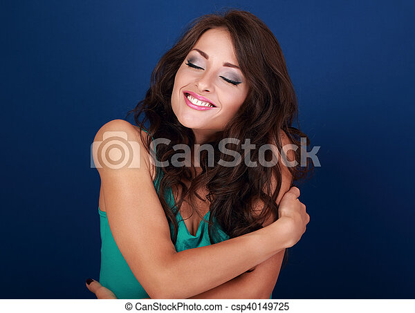 Happy makeup woman hugging herself with natural emotional enjoying face. Love concept of yourself body - csp40149725