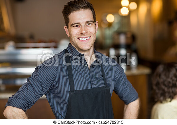 Happy Male Owner In Cafe - csp24782315
