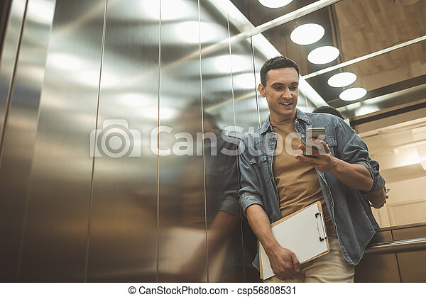 Happy male typing in phone - csp56808531