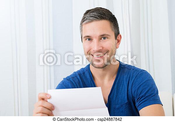 Happy Man Holding Letter - csp24887842