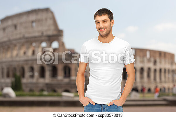 happy man in blank white t-shirt over coliseum - csp38573813