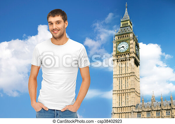happy man in blank white t-shirt over big ben - csp38402923