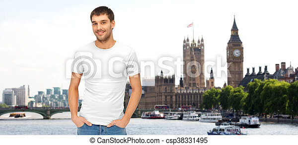 happy man in blank white t-shirt over london city - csp38331495