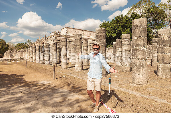 Happy man inviting you to visit the ruins - csp27586873