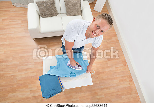 Happy Man Ironing Clothes - csp28633644
