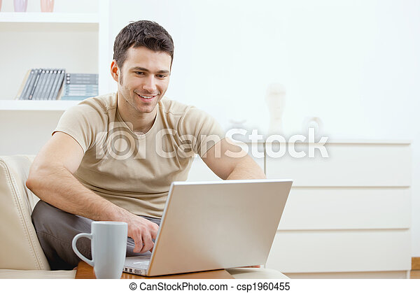 Happy man using computer - csp1960455