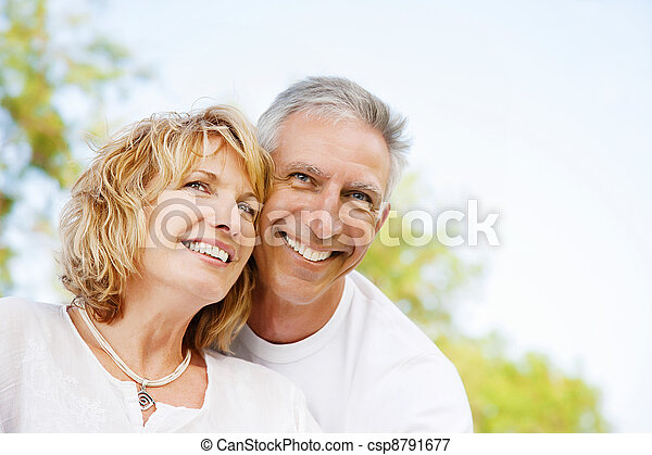Happy mature couple outdoors - csp8791677