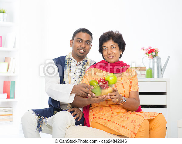 Happy mature Indian woman with her adult son - csp24842046