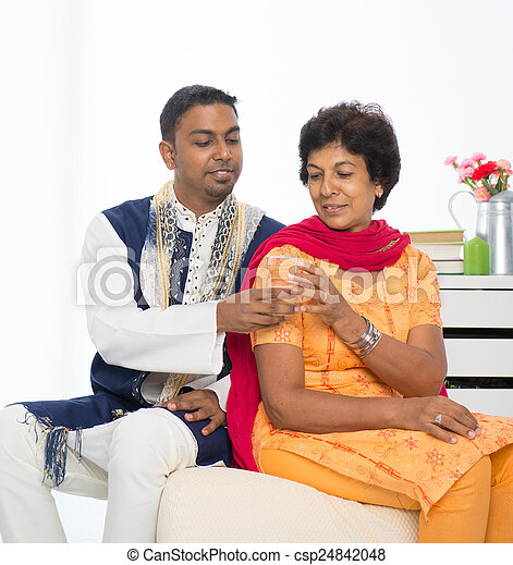 Happy mature Indian woman with her adult son - csp24842048