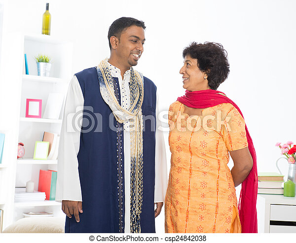 Happy mature Indian woman with her adult son - csp24842038