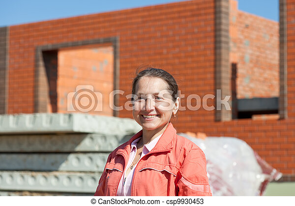 Happy mature woman against  building   - csp9930453