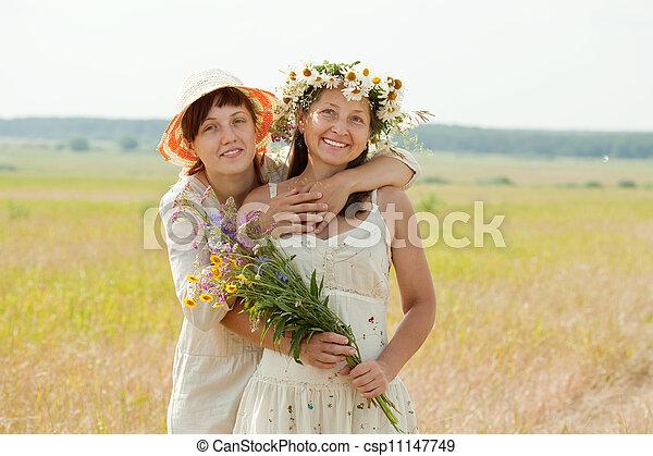 Happy  mature woman wirh adult daughter  - csp11147749