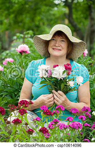 Happy mature woman with flowers - csp10614096