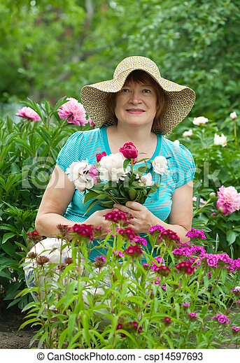 Happy mature woman with flowers   - csp14597693