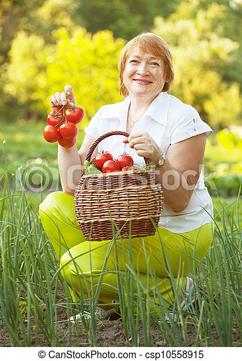 Happy mature woman with vegetables  - csp10558915