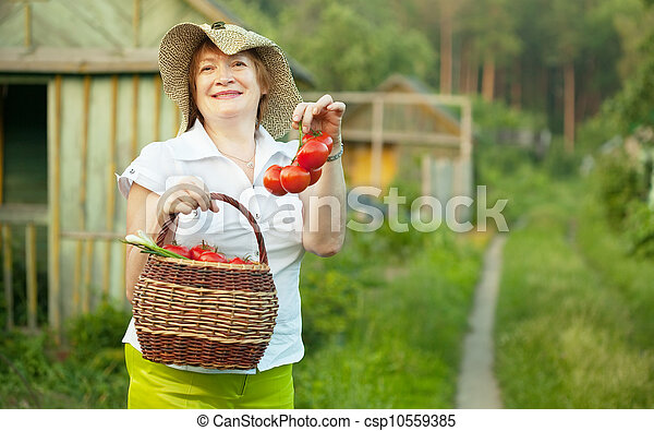 Happy mature woman with vegetables   - csp10559385