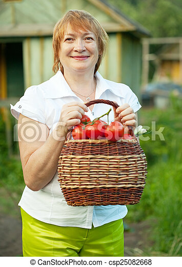 Happy mature woman with vegetables  - csp25082668