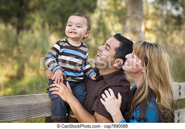 Happy Mixed Race Ethnic Family Playing In The Park - csp7890088