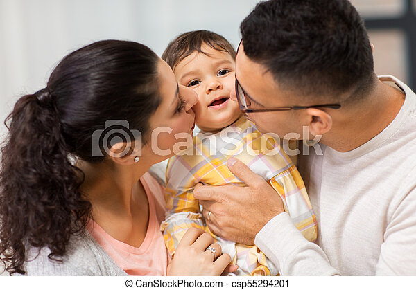 happy mother and father kissing baby daughter - csp55294201