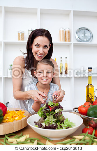 Happy mother and her girl preparing a salad - csp2813813