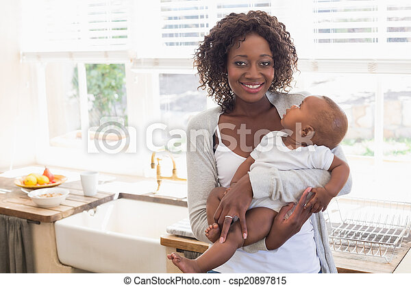 Happy mother holding her baby boy - csp20897815