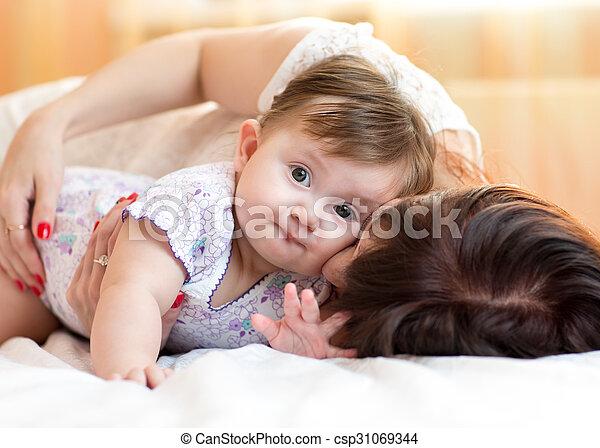 happy mother hugging her baby daughter - csp31069344