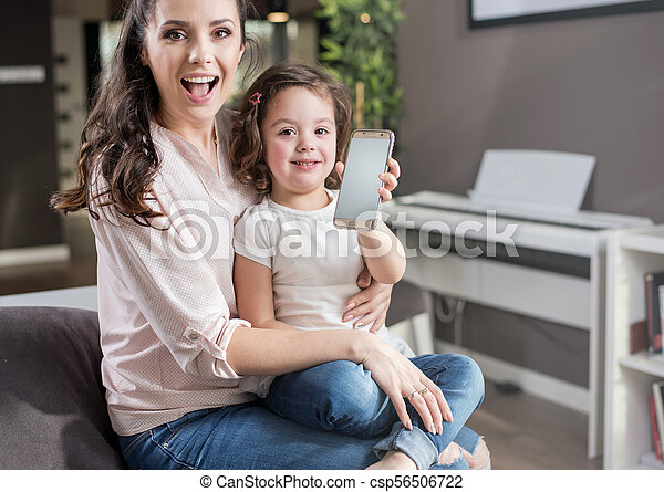 Happy mother with a daughter at home - csp56506722