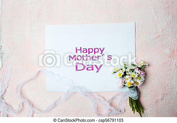 Happy Mothers day card with chamomile flowers - csp56791103