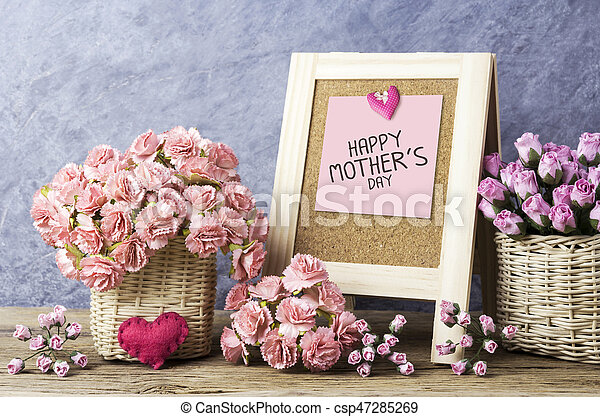Happy mothers day message on blackboard and paper carnation and rose flowers - csp47285269