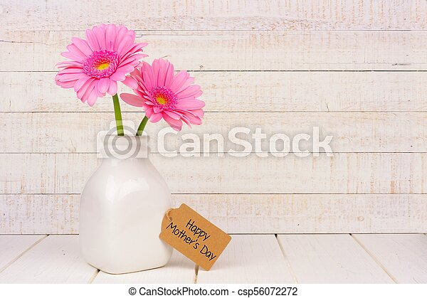 Happy Mothers Day tag with pink flowers against white wood - csp56072272