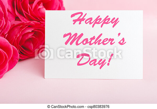 Happy Mothers Day text on gift card in flower bouquet of pink roses on pink background. Greeting card for Mom. Flower delivery, Congratulations card in flowers for women. Greeting card in roses - csp80383976