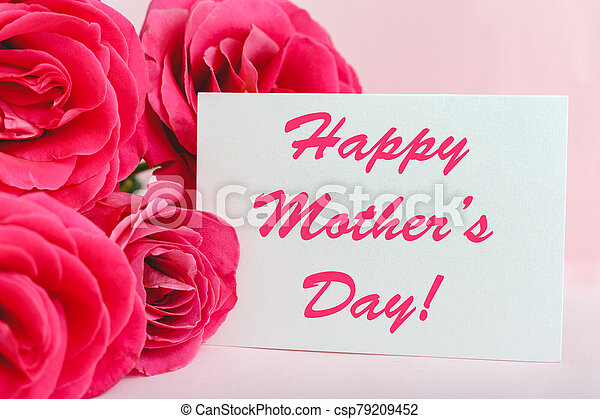 Happy Mothers Day text on gift card in flower bouquet of pink roses on pink background. Greeting card for Mom. Flower delivery, Congratulations card in flowers for women. Greeting card in roses - csp79209452